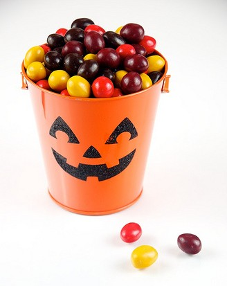 Colorful Halloween pumkin holding candies